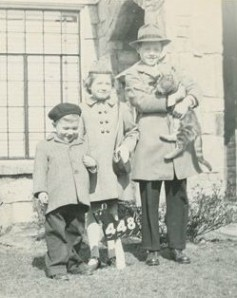 Photo of Siblings in Front of House